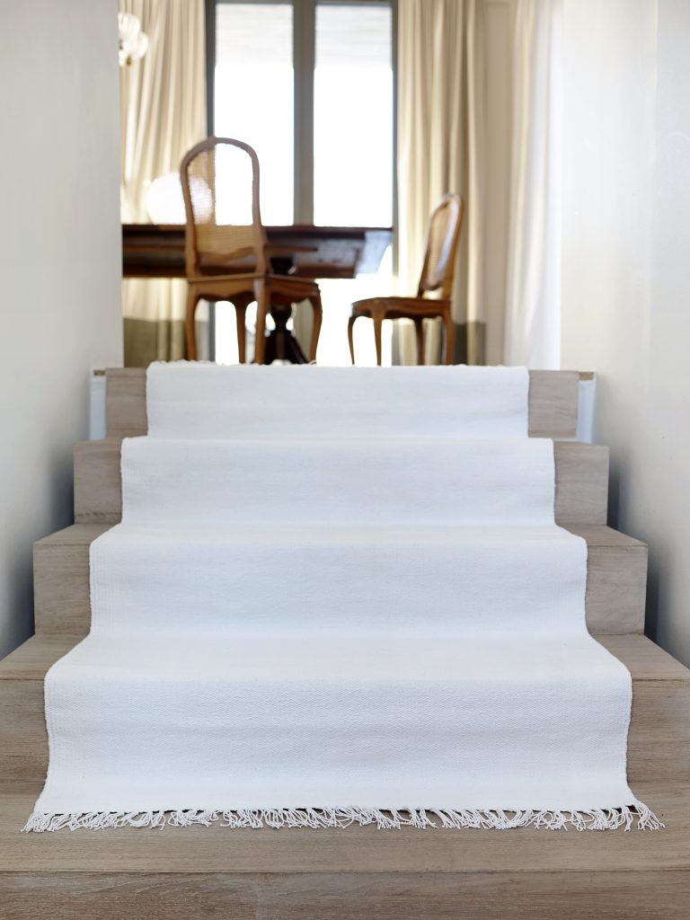 Wooden floors and white walls are complimentary.