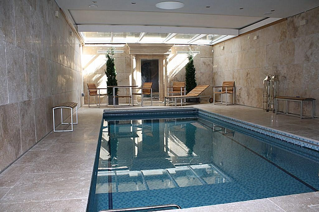 Indoor pool in basement by Kisiel Group builders London